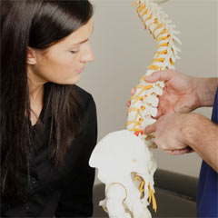 Chiropractic explaining something to a patient