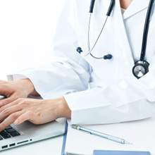A doctor using a computer